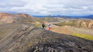 Hikers on rocky landscape