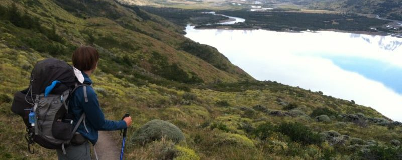 Hiker looking over river
