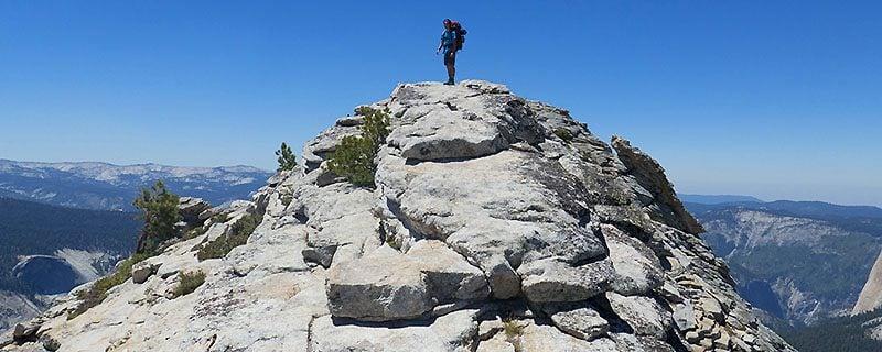 Hiker standing on rocky summit