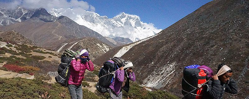 Hikers in foreground on Nepalese trail