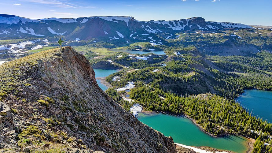 Man Hiking on Rugged Mountain Trail Overview
