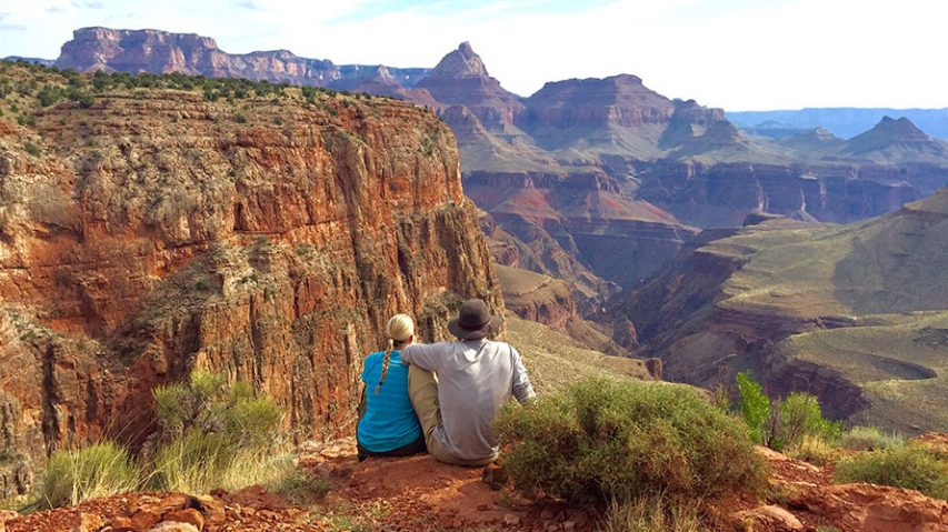 Two hikers overlooking cliff