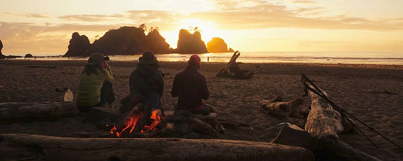 Hikers on the shore sunset
