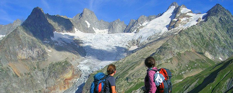 Hikers looking at massive glacier