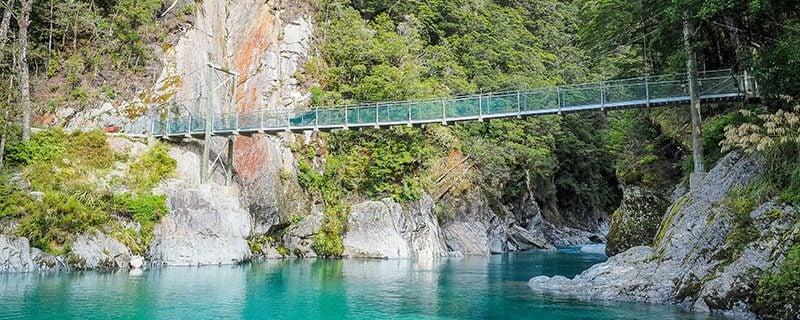 Suspension bridge over blue water