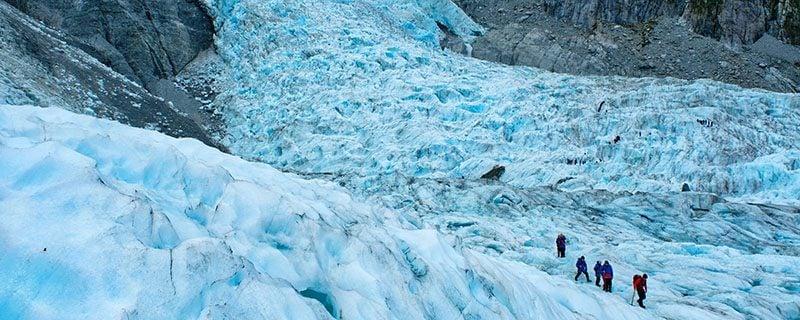 Hikers on massive glacier