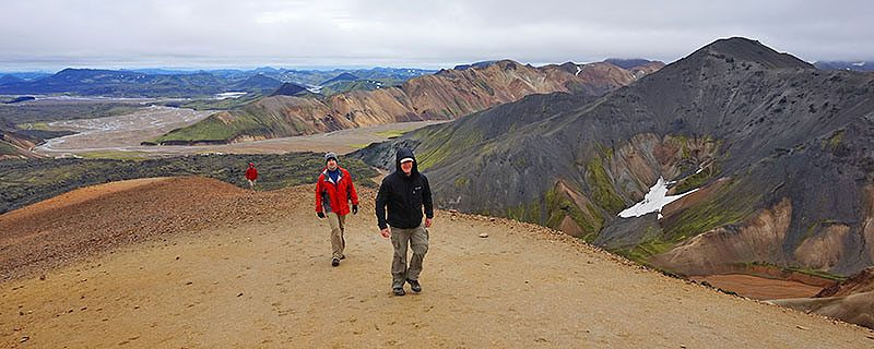 Two hikers on dirt trail
