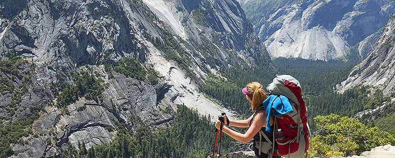Hiker overlooking spectacular mountain vista