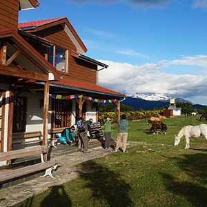 People on porch at a Patagonian inn