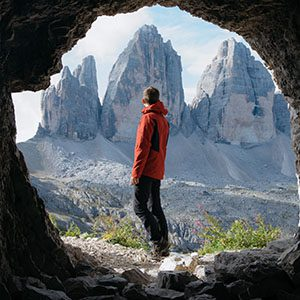 Hiker standing in front of amazing rock formations