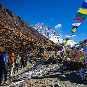 Hikers in Nepal with colorful flags