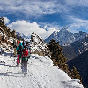 Hikers on snowy Nepal mountain
