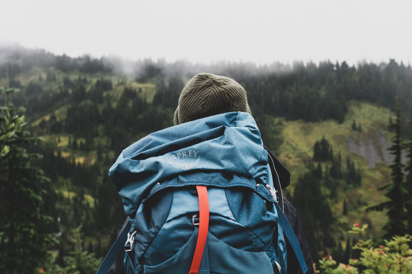 hiker with backpack, training for elevation gain